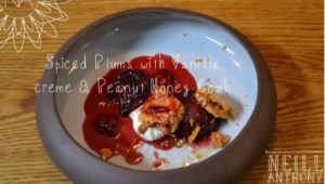 Neill Anthony's spiced plums with vanilla creme and peanut honeycomb