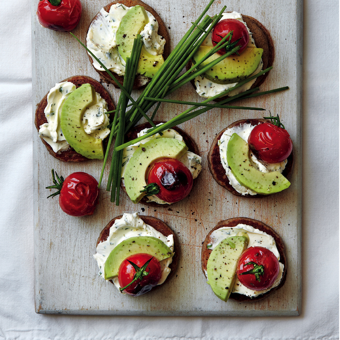 Buckwheat blini with herbed cream cheese, avo and vine tomatoes