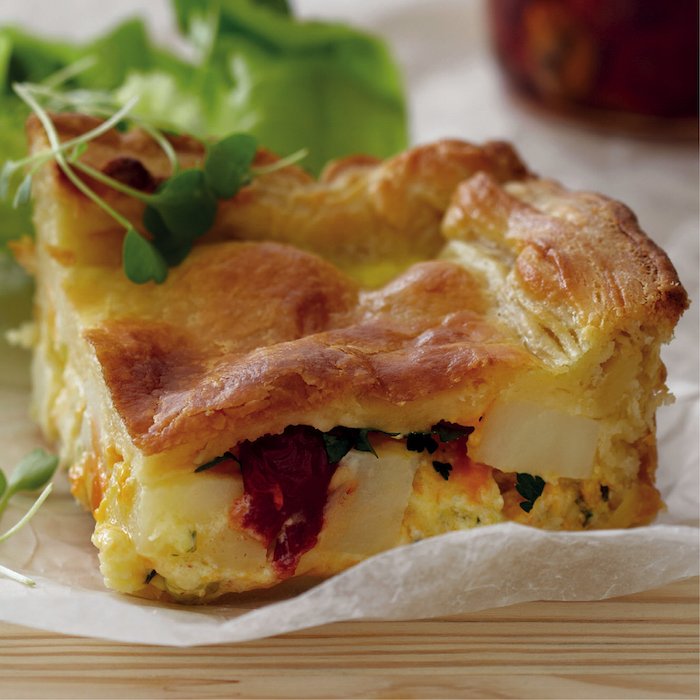 Three-cheese pie in cream cheese pastry
