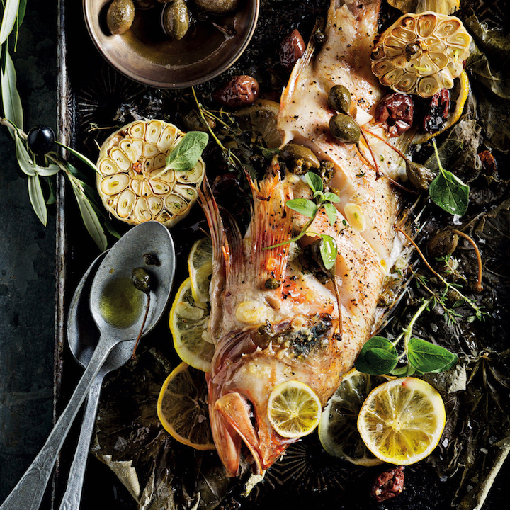 Whole baked fish with olives and capers