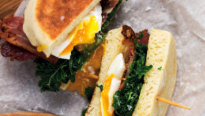 English muffins with bacon, egg and kale