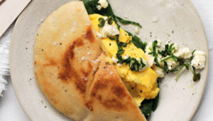 Pita with scrambled egg, spinach and feta