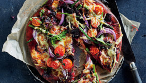 Beetroot pizza with asparagus and Emmental