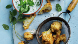 Beer-battered cauliflower fritters with yoghurt sauce