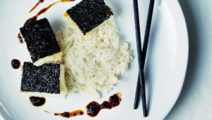 Black sesame crusted fish with coconut rice and crushed olive glaze