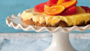 Labneh cheesecake with peanut crust and citrus compote