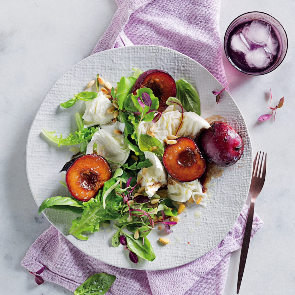 Summer salad with balsamic-glazed plums and buffalo mozzarella