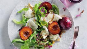 Summer salad with balsamic-glazed plums and buffalo mozzarella