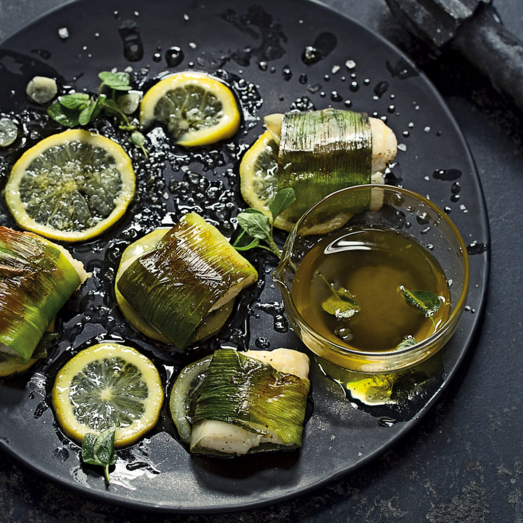 Leek-wrapped fish with confit lemon