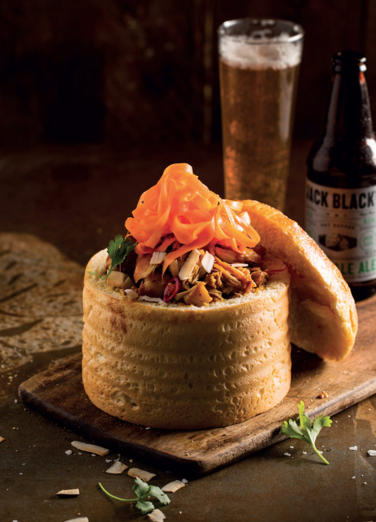 Chicken curry bunny chow with carrot-pickle