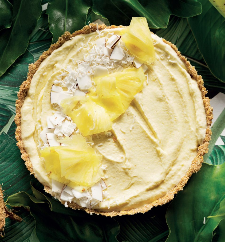 Frozen banana breakfast tart with shaved pineapple and coconut