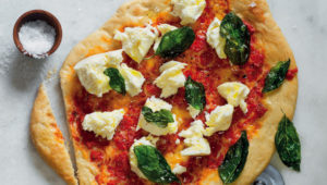 Pizza with crispy basil