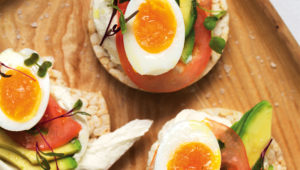 Egg, avocado and tomato rice-cake stacks
