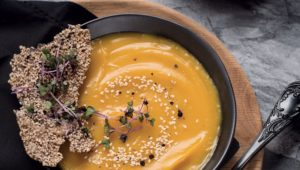 Golden sweet potato soup with sesame seed crackers