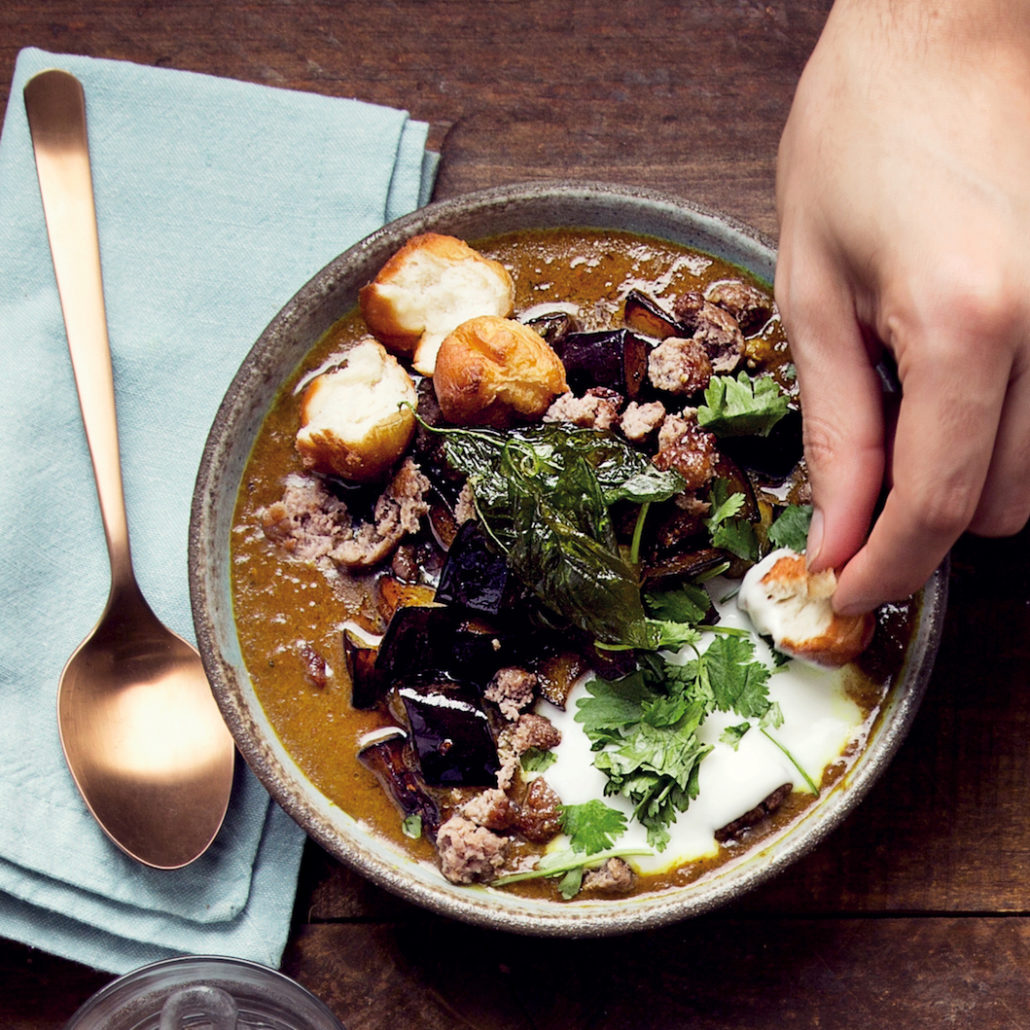 Curried mince soup with mini vetkoek croutons and basil crisps
