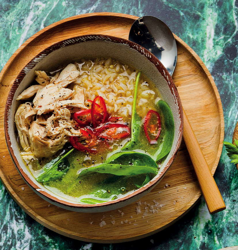 Rice and chicken broth bowl with baby spinach