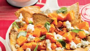 Butternut and creamy tomato nacho bake