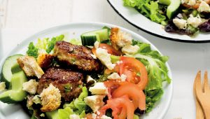 Traditional garden salad with boerewors patties