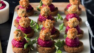 Rye toast bites with fried olives and beetroot dip