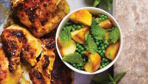 Roast chicken with pea and mint roast potatoes