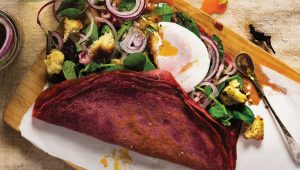 Beetroot crêpes with salad lyonnaise