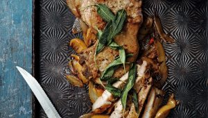 Onion and apple pork chops with butter bean mash